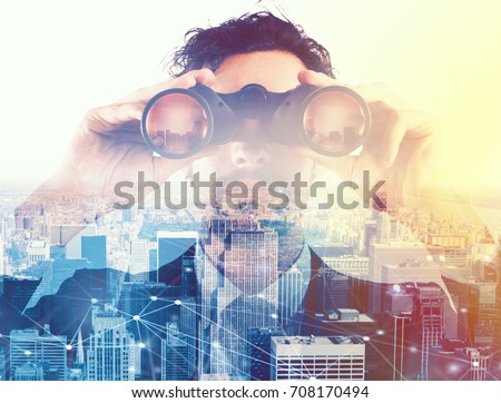 Businessman looking to the future with binoculars