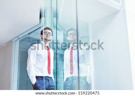 businessman looking to the window