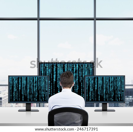 businessman looking to three screen with matrix background - stock photo