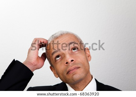 Businessman looking up - stock photo