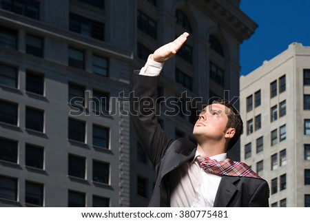 Businessman looking up at sunlight - stock photo