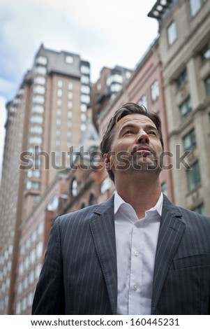 Businessman Looking Up To The Future  - stock photo