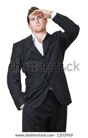 Businessman looking up with his hand  in front of his forehead