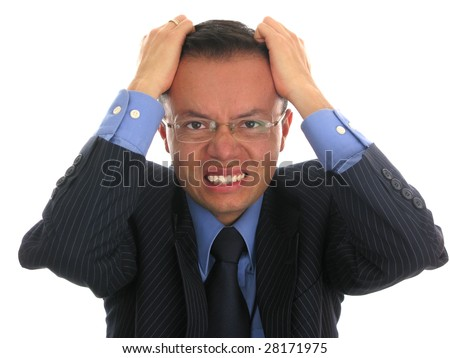 Businessman looking upset, pulling his hair off. - stock photo