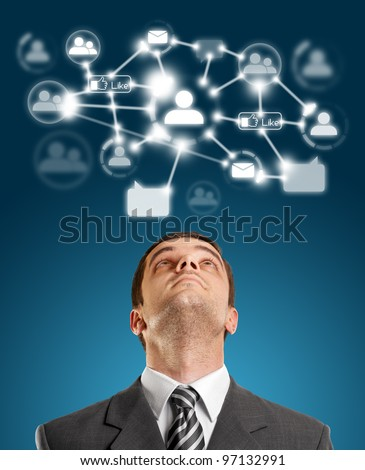 Businessman looking upwards in social network - stock photo