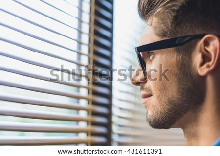 businessman looking with hope in the window