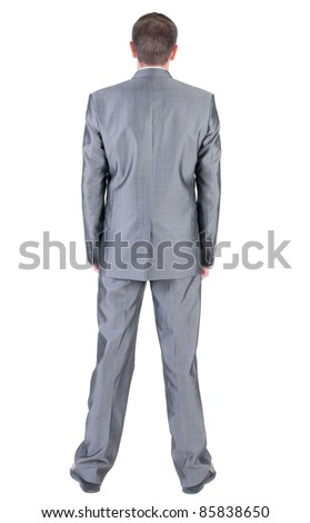 Businessman  looks ahead. rear view. Isolated over white . - stock photo