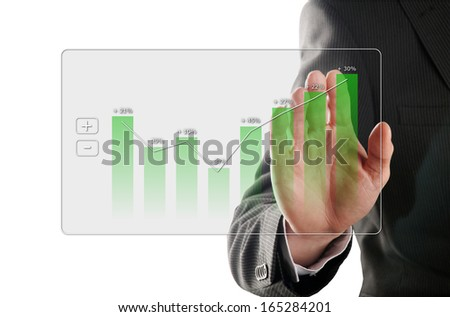 businessman looks at the development of the profit in a chart - stock photo