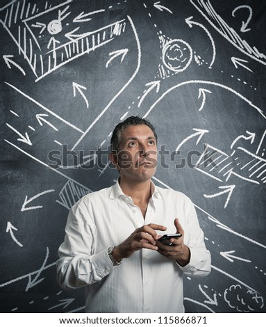 Businessman looks for a street with gps - stock photo
