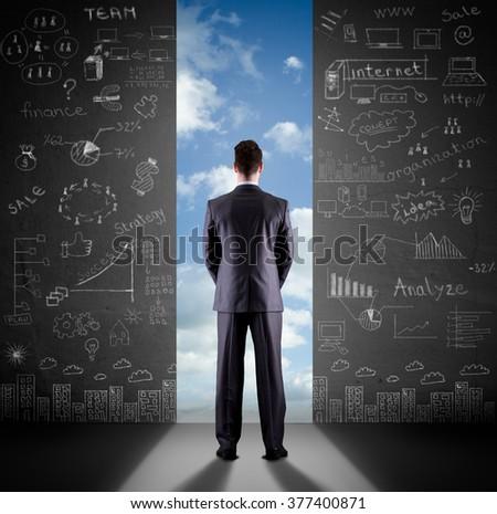 Businessman looks into the future - stock photo