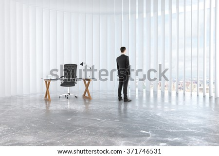 Businessman looks out the window in empty loft room with glassy table, leather chair and concrete floor 3D Render - stock photo