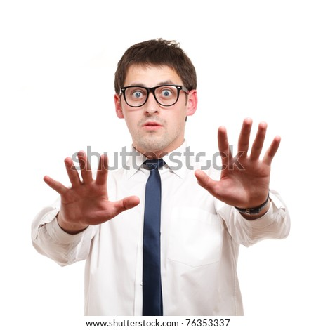 Businessman looks shocked. Isolated over white. - stock photo