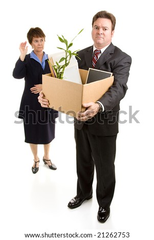 Businessman loses his job due to corporate downsizing while a sad coworker waves goodbye.  Full body isolated on white. - stock photo