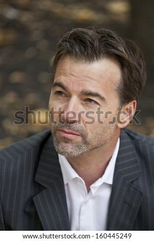 Businessman lost in thoughts - stock photo