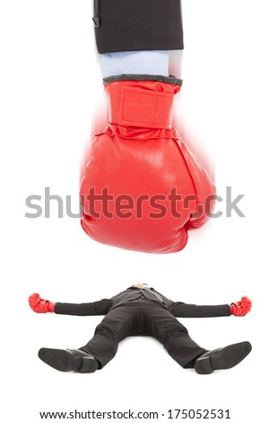 Businessman lying on the ground by a knockout punch - stock photo