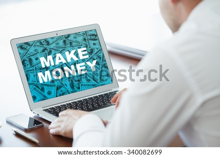 Businessman  make money on virtual screens. Business, technology, internet and networking concept. - stock photo