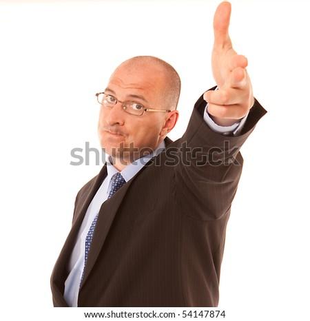 Businessman making a gun sign suggesting he id firing someone - stock photo
