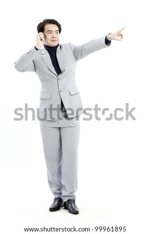 Businessman making a phone call against a white background - stock photo