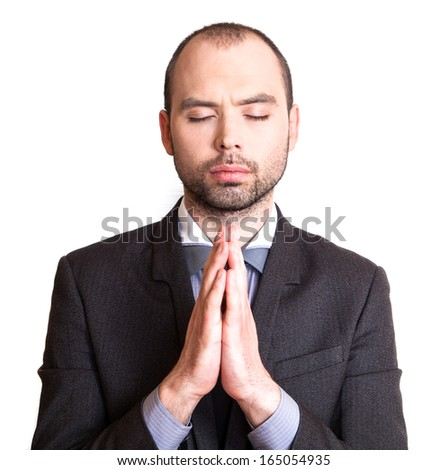 Businessman making a prayer. - stock photo