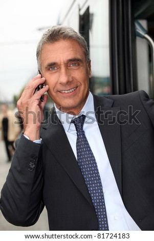 businessman making call outdoors - stock photo