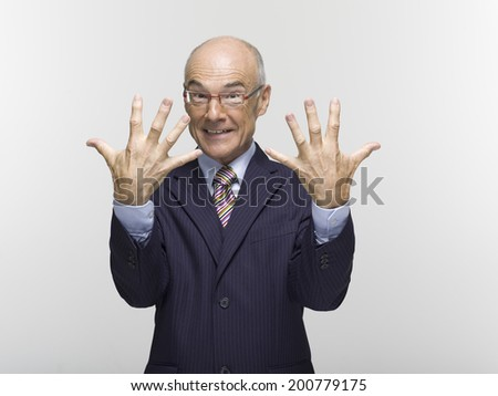 Businessman making hand gesture