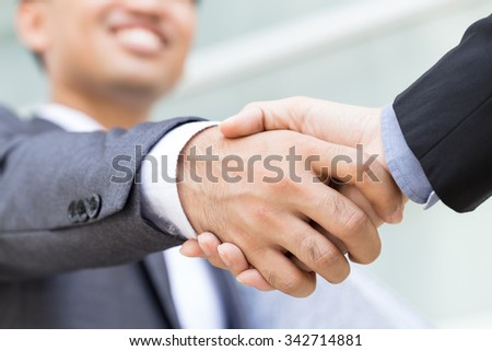 Businessman making handshake
