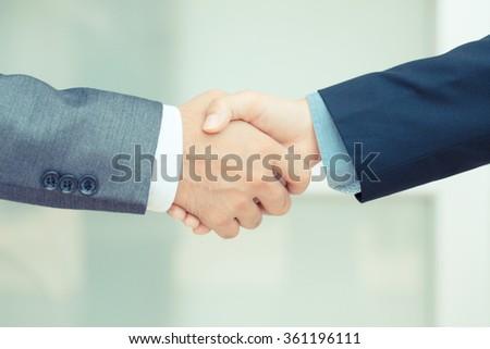 Businessman making handshake, vintage color tone - stock photo