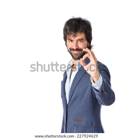 Businessman making Ok sign over white background