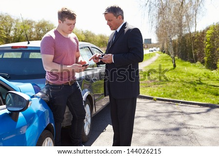 Businessman Making Phone Calls After Traffic Accident - stock photo