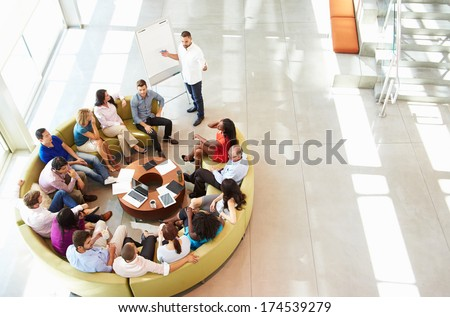 Businessman Making Presentation To Office Colleagues - stock photo