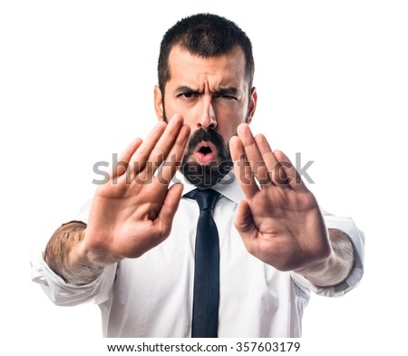 Businessman making stop sign - stock photo