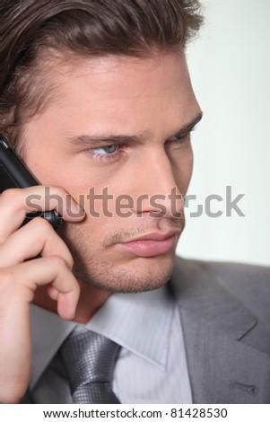 Businessman making telephone call - stock photo