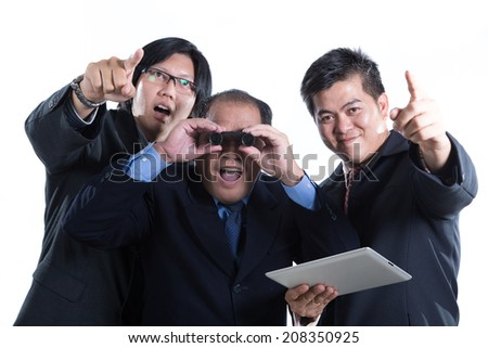 Businessman manager holding binoculars for check this stock with white background - stock photo