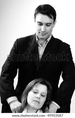businessman massaging his colleague - stock photo