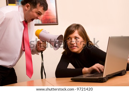 Businessman, may be a boss yelling on his associate at office - stock photo