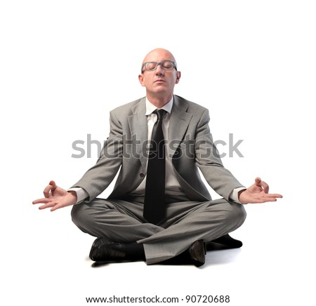 Businessman meditating - stock photo
