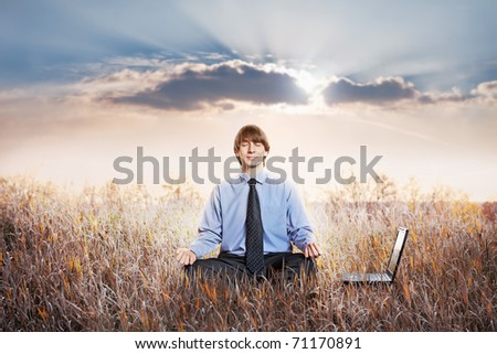 Businessman meditating in lotus pose. Business yoga