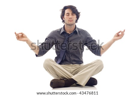 Businessman meditating in lotus position isolated over white background - stock photo