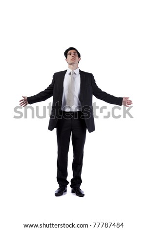 Businessman meditating with his eyes closed and arms open (isolated on white) - stock photo