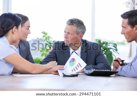 Businessman meeting with colleagues using laptop in the office
