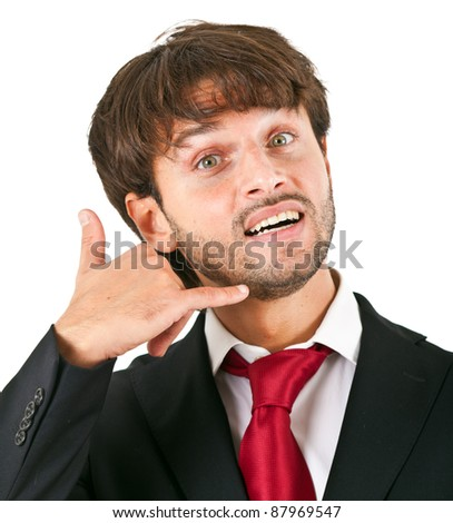 Businessman miming a phone with his hand - stock photo