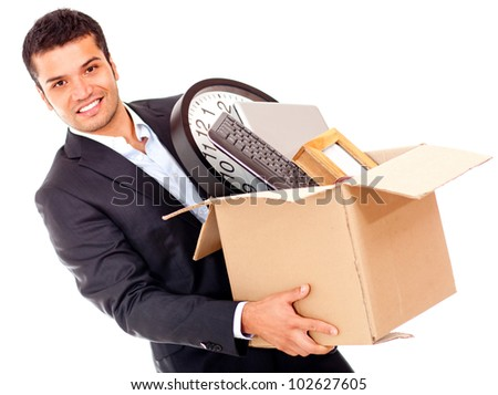 Businessman moving into a new office holding a box - isolated - stock photo