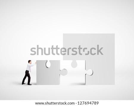businessman moving puzzle  on white background - stock photo