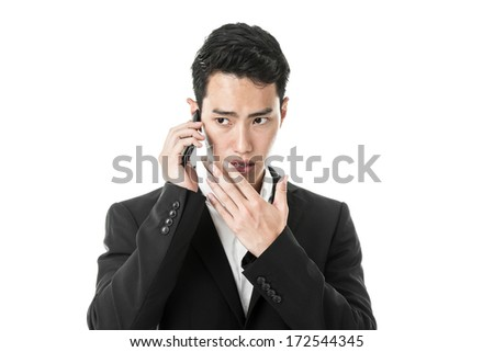 Businessman murmuring to the phone