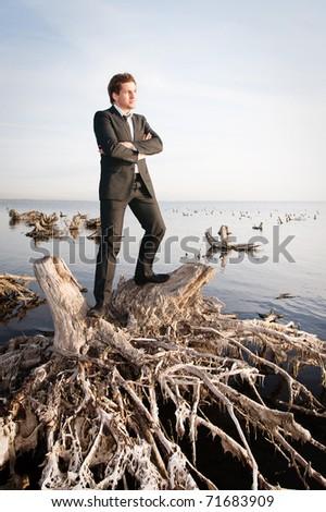 businessman near the water - stock photo