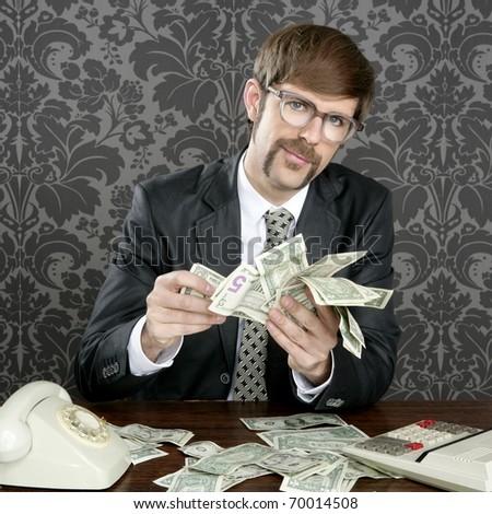 businessman nerd accountant dollar notes on vintage wallpaper office - stock photo
