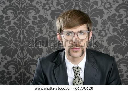 businessman nerd retro glasses geek portrait on vintage wallpaper - stock photo