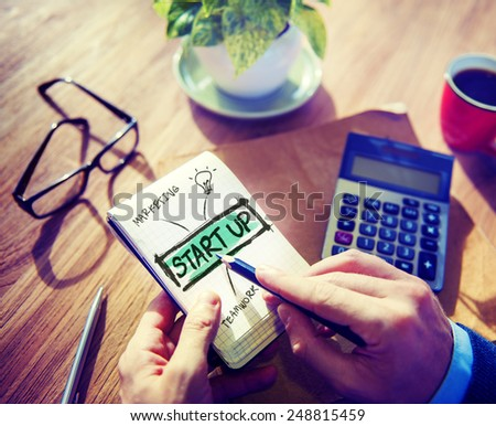 Businessman Notepad Start Up Concept - stock photo