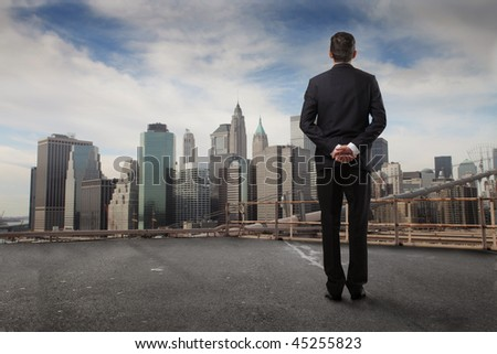Businessman observing a urban background - stock photo