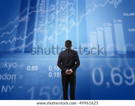 Businessman observing some statistics in front of him